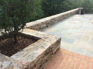Mixed stone patio and walls
